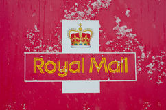 Royal Mail sign covered with snow. IPSWICH, UK - MARCH 24: Royal Mail sign covered with snow. Severe weather conditions are causing disruptions to services in Royalty Free Stock Images