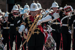 Royal marine band of Scotland. Marching through Liverpool Albert dock. Music being played on various instruments. Drum trumpet Stock Photography