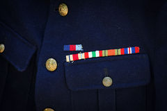 Royal Marine medal ribbons on blue R.M. uniform Stock Photo