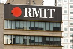 Melbourne, Australia - May 21st 2019: RMIT sign on the top of a city campus building royalty free stock image