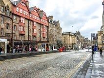 The Royal Mile street in Edinburgh old town, UK. EDINBURGH, UNITED KINGDOM - APRIL 15, 2015: Tourists walk at The Royal Mile street in Edinburgh old town, UK Stock Photography