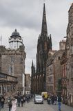 Royal Mile, touristic street of Old Town Edinburgh City in Scotland with with Tron Kirk or The Hub. Edinburgh, Scotland - April 2018: Royal Mile, touristic royalty free stock image