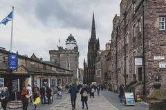 Royal Mile, touristic street of Old Town Edinburgh City in Scotland with with Tron Kirk or The Hub. Edinburgh, Scotland - April 2018: Royal Mile, touristic stock photos