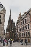 Royal Mile, touristic street of Old Town Edinburgh City in Scotland with with Tron Kirk or The Hub. Edinburgh, Scotland - April 2018: Royal Mile, touristic stock photography
