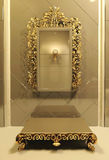Royal mirror with gold frame in luxury interior Royalty Free Stock Photography