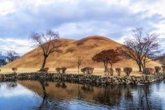 Royal mounds reflection. S on a small pond in daereungwon, gyeongju, south korea Stock Image