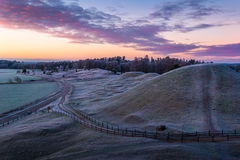 Royal mounds 2. Sunrise view of the King's graves in Gamla Uppsala, Sweden stock image