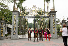 Royal Museum Armed Guards. KUALA LUMPUR, MALAYSIA - FEBRUARY 17: Tourists taking photo with armed guards in traditional Malay costume at the entry gate of Royal royalty free stock image