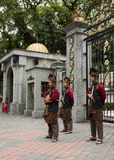 Royal Museum Armed Guards. KUALA LUMPUR, MALAYSIA - FEBRUARY 17: Armed guards in traditional Malay costume stand at the entry gate of Royal Museum in Kuala stock image