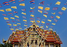 Royal and national flags of Thailand waving in blue sky Stock Images