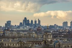 Royal Naval College and City of London skyscrapers stock images