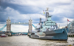 Royal Navy Cruiser HMS Belfast Moored in Thames with Tower Bridge in Background, London, England Royalty Free Stock Photography