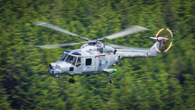 Royal Navy Lynx helicopter. A Royal Navy Lynx helicopter conducting a low level sortie through a Welsh valley, United Kingdom. 23rd June 2015 stock photo