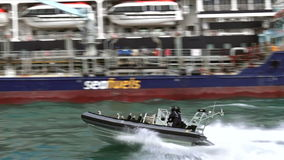 Royal New Zealand navy sailors ride a Zodiak boat. Royal New Zealand navy sailors ride a Zodiak Rigid-hulled inflatable boat in ports of Auckland. The RNZN has a stock video