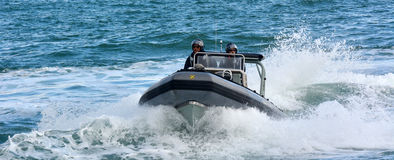 Royal New Zealand navy sailors ride a Zodiak Rigid-hulled inflat. AUCKLAND, NZL - JAN 30 2016:Royal New Zealand navy sailors ride a Zodiak Rigid-hulled Royalty Free Stock Photography