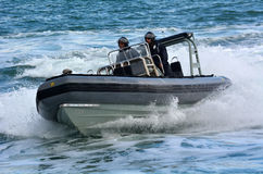 Royal New Zealand navy sailors ride a Zodiak Rigid-hulled inflat Royalty Free Stock Photography