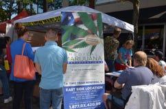 Royal Oaks Arts Beats and Eats Marijuana stand. ROYAL OAK, MI - SEPTEMBER 3: Onlookers visit medical marijuana booth at Royal Oak Arts Beats and Eats festival in royalty free stock image