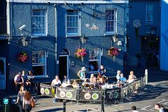 The Royal Oak Pub, Weymouth. Tourists relaxing outside The Royal Oak pub in the harbour, Weymouth, Dorset, England, UK, Western Europe Royalty Free Stock Image