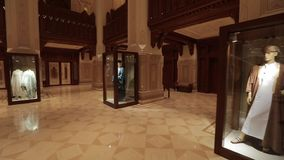 Royal Opera House Muscat. Muscat, Oman - February, 2019: Royal Opera House Muscat. The opera building is inside. Hall decoration, mannequins with traditional stock footage