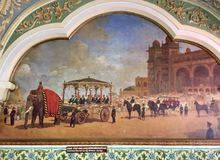 Elephant carriage and Nine seater carriage in the princely state of Mysore. Royal painting depicting an elephant carriage and a nine seater carriage driven by stock images