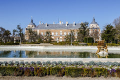 Royal Palace of Aranjuez is a residence of the King of Spain. Aranjuez , Spain - March 13 , 2016:  View at the fountain in garden of Royal Palace of Aranjuez Royalty Free Stock Photo