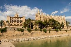 Royal Palace of La Almudaina and Cathedral La Seu. In Palma de Mallorca, facing Parc de la Mar Royalty Free Stock Image