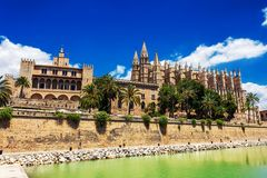 The Royal Palace of La Almudaina and La Seu Cathedral historic buildings in Palma de Mallorca royalty free stock photo