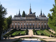 Royal Palace of la Granja de San Ildefonso Segovia Spain. The facade and the simmetrical gardens with a fountain of the Royal Palace of la Granja de San Stock Photography