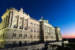 Royal Palace of Madrid at dusk Stock Image
