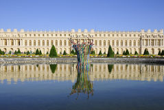 Royal palace and modern fountain Royalty Free Stock Photo