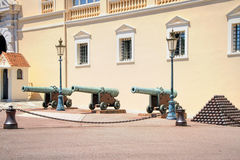 Royal Palace (Monaco Ville). Pyramids of cannonballs and cannon near Prince Palace in Monaco Stock Image