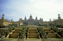 Royal Palace in Morning light. View of the Royal Palace in Barcelona, Spain, with its magnificent water feature and gardens in the early morning mist stock photos