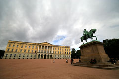 Royal Palace, Norway, Oslo. A Royal Palace of Oslo, Norway. Cloudy day, wide angle, a monument and a building, some tourists around Stock Photos