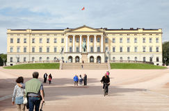 Royal palace in Oslo. Oslo, Norway - September 16, 2016: Frontal view of the royal palace in Oslo, Norway, with people strolling Stock Photos