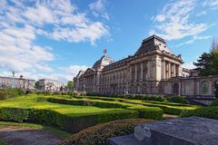 The Royal Palace Palais de Bruxelles in center of Brussels, view from Place des Palais. Sunny spring day. Brussels, Belgium.  stock photos