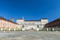 Royal Palace Palazzo Reale building on Castle Square Piazza Castello with fountains and monuments in historical centre of Turin. Torino city with clear blue sky royalty free stock photography