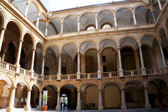The Royal Palace in Palermo,Sicily. View of the multilevel arcade in the internal court of the Palace of Normans in Palermo,Sicily Royalty Free Stock Photos