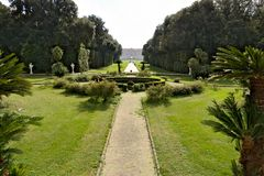 Reggia di Caserta, Italy. 10/27/2018. Royal Palace Park. The design of a circular pool surrounded by a green lawn stock images