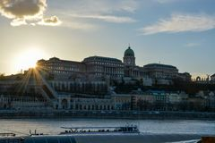 Royal Palace at the river Danube in Budapest during sunset. The Royal Palace at the river Danube in Budapest during sunset royalty free stock photos