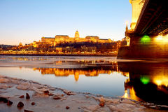 The Royal Palace at sunset over the icy Danube River, Budapest, Royalty Free Stock Photos