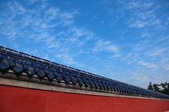Royal palace wall. Oriental royal palace wall with blue top under cloudy sky Royalty Free Stock Images