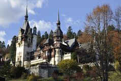 Royal Peles Castle in autumn from Sinaia in Romania Stock Photography