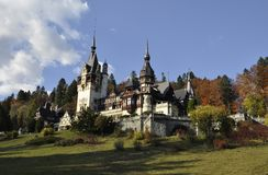 Royal Peles Castle in autumn from Sinaia in Romania Royalty Free Stock Photography