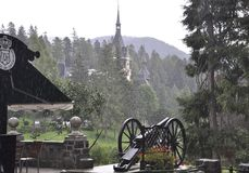 Royal Peles Castle in a rainy day from Sinaia in Romania Royalty Free Stock Photography