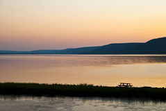 Royal Picnic. Cape Breton Bras d'Or Lake at Sunset with Picnic Table Stock Images