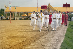 The Royal Plowing Ceremony in Thailand. BANGKOK, THAILAND - MAY 13,2015 : Unidentified Government officials scatter the water attend the ceremony -Perform for Stock Photos