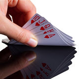 Royal poker in hand. With reflection stock photo