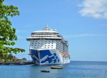 Royal Princess ship in Dominica. DOMINICA, CARIBBEAN - MARCH 24, 2017 : Royal Princess ship docked in Roseau port. Royal Princess is operated by Princess Cruises royalty free stock image