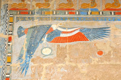 Royal Protection. The royal protection of the vulture in painted bas-relief at the new kingdom mortuary temple of Queen Hatshepsut at Thebes in Egypt Royalty Free Stock Photos