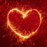 Royal red background with glowing heart Stock Photo